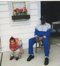 Hicey Ross Jr and Granddaughter Christa in his backyard on Winthrop Street, Detroit 2001