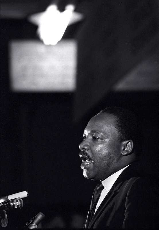 FILE - In this April 3, 1968 file photo, Dr. Martin Luther King Jr. makes his last public appearance at the Mason Temple in Memphis, Tenn. The civil rights leader was standing on the balcony of the Lorraine Motel when he was killed by a rifle bullet on April 4, 1968. James Earl Ray pleaded guilty to the killing and was sentenced to 99 years in prison. He died in prison in 1998. (AP Photo/Charles Kelly, File)