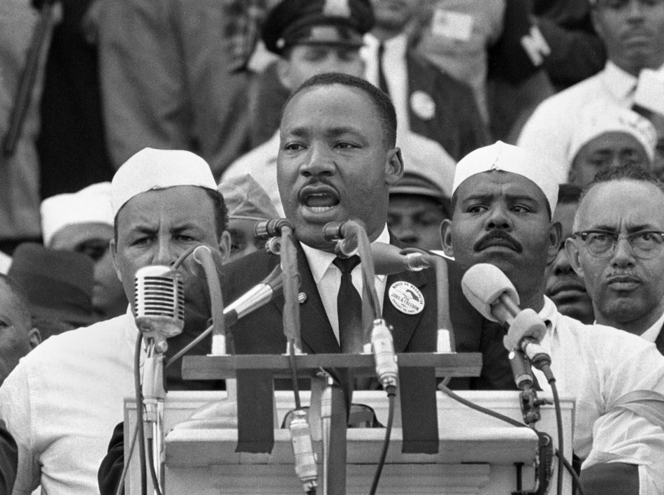 "FILE- In this Aug. 28, 1963, black-and-white file photo Dr. Martin Luther King Jr. addresses marchers during his ""I Have a Dream"" speech at the Lincoln Memorial in Washington. Former South African president Nelson Mandela never met with King but the two fought for the same issues at the same time on two different continents. Mandela said in a 1964 speech that he was prepared to die to see his dream of a society where blacks and whites were equal become reality. King was killed by an assassin's bullet while working for that same dream.(AP Photo/File)"